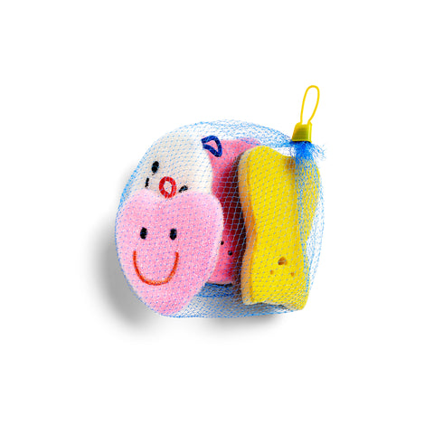 Four colorful, differently shaped sponges bundled together in a blue produce-style net bag. The two sponges at the forefront are a pink heart with an embroidered smiley face, and a yellow cat with a small face cut-out.