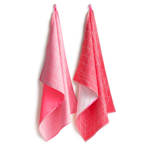 Two contrasting bright and hot pink tea towels with grid pattern detail.