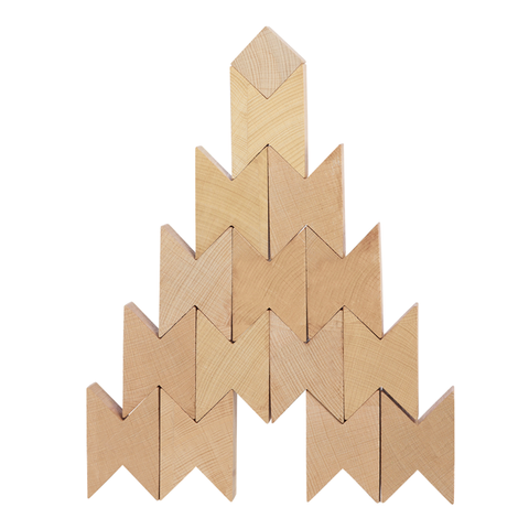 14 Beech wood blocks with cut-outs at the end allowing the blocks to nest together. The blocks are stacked into a tower with a single cube block on top.