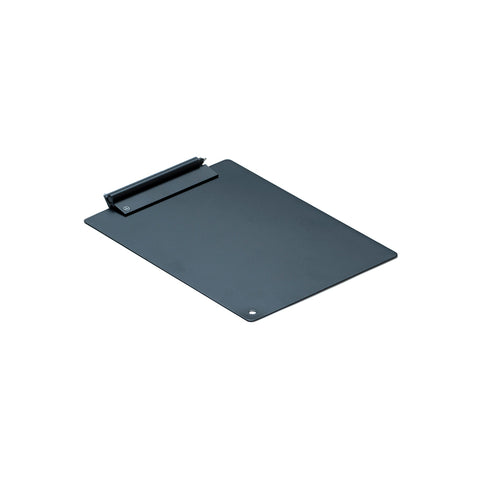 Quarter view of the HMM Clipboard; a flat, matte black, rectangular piece of metal with rounded corners and a hole cut into the bottom left. The rectangular, sharp cornered clip on the short, top end of the board is also matte black and holds a matching pen.