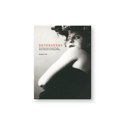 Book cover with black and white photograph of a figure whose back is to us but twisting their head back to us. The figure is wearing a dark lip shade and a lacy dark veil. Title in orange and black font to the left