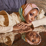 Image of model in fancy dress wearing silk scarf on her head.