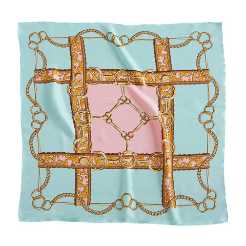 Scarf laid flat showing full pattern in turquoise with gold colored accents and pink center.