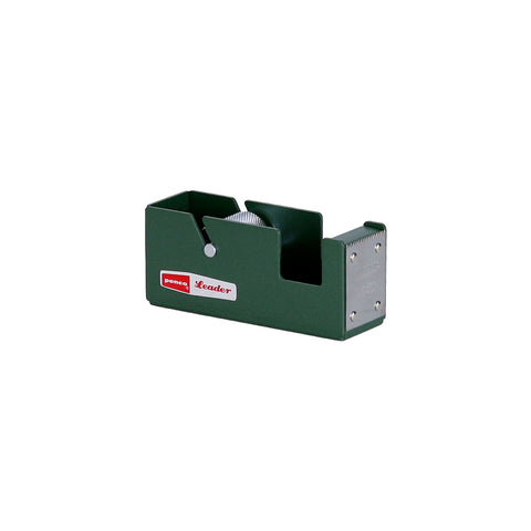 A dark green rectangular shaped dispenser with two slots cut out for a tape roll. The textured steel spool is visible inside the smaller slot. A steel plaque on the front panel has a serrated edge. A red and white retro styled Penco logo is on the side panel.