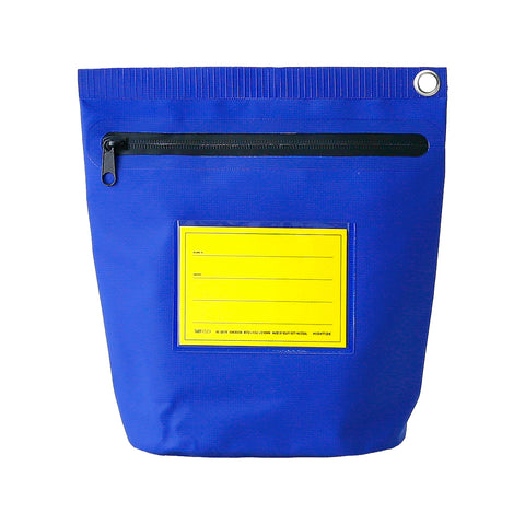 A tall rectangular blue pouch has a silver grommet in the top corner and a black zipper closure. The front of the pouch has a transparent pocket with a removable blank yellow label.