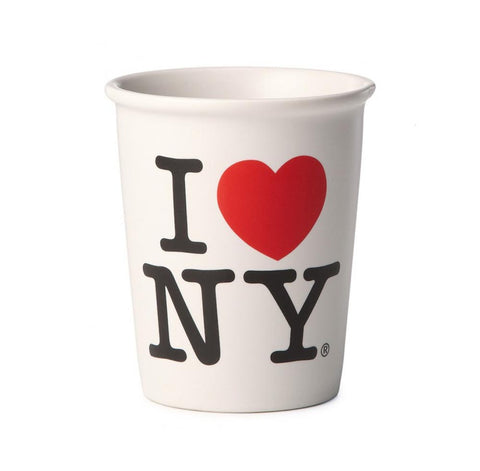 "White ceramic mug features Milton Glaser's iconic symbol ""I Love NY""."