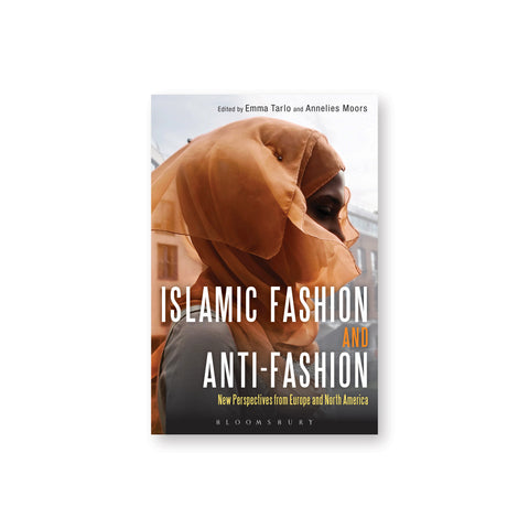 Book cover featuring a photograph of a woman in profile wearing a gauzy orange hijab. The book title is overlaid in tall white and orange text