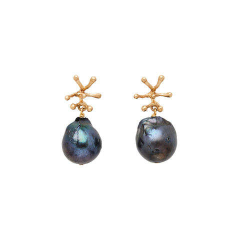 Flat view of Stamen Midnight Pearl Earrings. A large, irregular black pearl dangles from a small, bronze stamen shape, which is attached to a earring post.