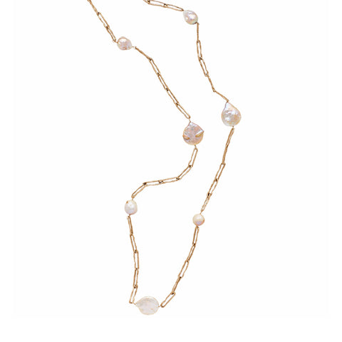 Flat view of the Preza Pearl Necklace. The necklace is a bonze, narrow, rectangular chain link with medium-large, irregular pearls every five links. The top of the necklace is cropped out, you can see 7 pearls.