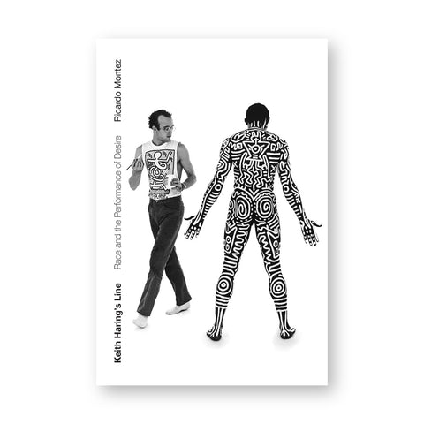 White book cover features a black and white photo of Keith earrings with a brush and black male model, his body is entirely decorated with Harring's drawings in white paint.
