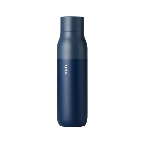 A powder-coated steel water bottle in navy blue. The bottle features a flat round cap. The name of the company is vertically printed upward and in silver.