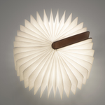 A Lumio standing upright is open 360 degrees forming a complete circle. Light illuminates from within.