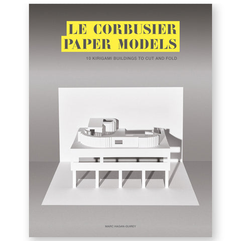 Book cover featuring an all-white paper model of the modernist home Villa Savoye, designed by famed architect Le Crobusier. the model display sits in a dark grey to light grey gradient background. The title is centered at the top of the book cover, using a cut-out font with yellow edging.