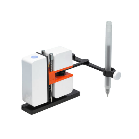 "A compact, minimalist design featuring a shiny black rectangular base below three matte white cubes; one elongated a blue dot on top, and two stacked cubes bisected by an orange flange with springs and two black ""arms"" attached to a long perpendicular pen holder with an opaque pen."