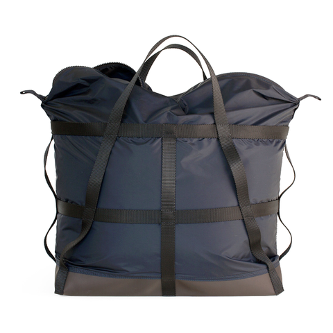 Large navy colored nylon bag with lattice webbing detail and durable vinyl base