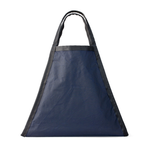 Medium-sized triangle shaped bag with navy body and black nylon trim