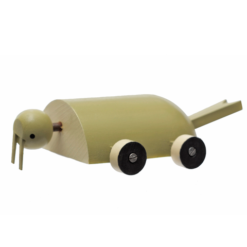 Walrus Toy Side view of a rollable toy walrus hand-made from wood and hand-painted in shades of brown with wheels for feet.