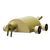 Frontal view of a rollable toy walrus, emphasizing its long wooden tusks,  hand-made from wood and hand-painted in shades of brown with wheels for feet.