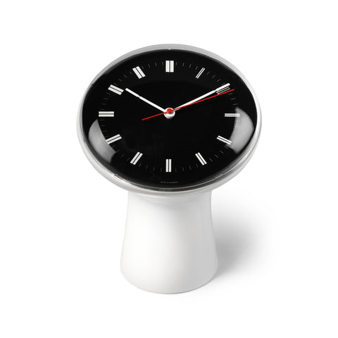 White ceramic circular stand gradually expanding to frame the clock's black face, which is covered with protective glass. The white dials are marked with II, the hour and minute hands are white, the second hand is red.