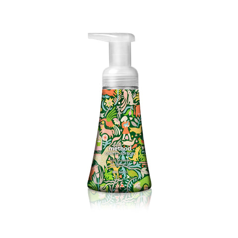 Soap dispenser with a wrapped pattern on the bottle of animals and foliage on a green background. Small text on the bottle reads: Method Limited Edition.
