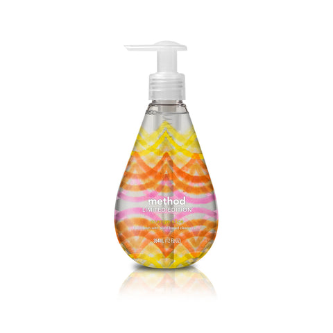 Drop shaped soap dispenser with a wrapped abstract, scalloped pattern resembling citrus. Small text on the bottle reads: Method Limited Edition.