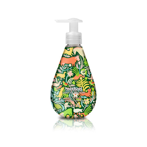 Drop shaped soap dispenser with a wrapped pattern on the bottle of animals and foliage on a green background. Small text on the bottle reads: Method Limited Edition.