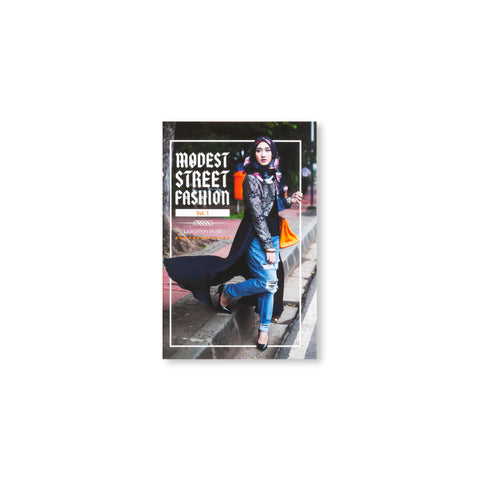 Small book cover featuring a street-style photograph of a woman wearing stilettos, ripped jeans, a long coat with brocade detail, and a floral hijab. A white line border frames her. Text overlaid reads: Modest Street Fashion Vol. 1.