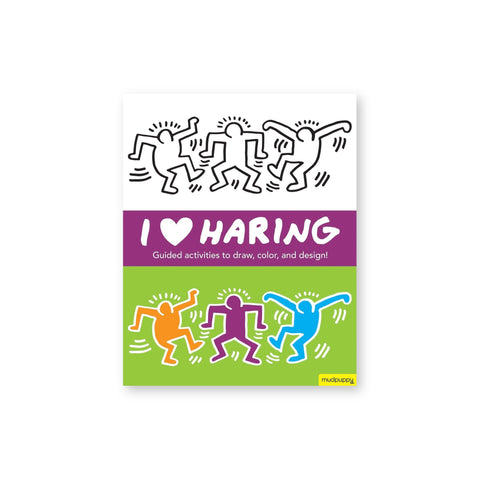 "Rectangular book cover featuring one black and white Keith Haring drawing, and the same drawing in color below. White text on a purple band between the two drawings reads ""I Heart-Symbol Haring"""