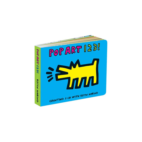 "Small, rectangular board book featuring a yellow Keith Haring Barking Dog drawing on a vibrant blue background. Hand-drawn text above reads ""Pop Art 1 2 3 !"""