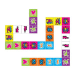 A layout of the Keith Haring dominoes. Instead of traditional dots, the pieces feature colorful Keith Haring drawings.