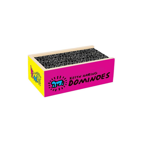 "Closed box of dominoes with colorful sides and a black top featuring Keith Haring drawings. Text on one side reads ""Keith Haring Dominoes"""