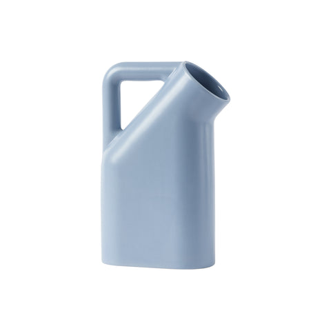 A pale blue jug with smooth rounded corners, a wide round mouth and tubular handle.