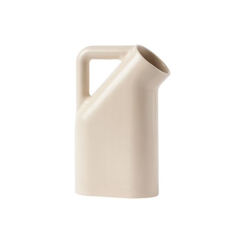 A cream colored  jug with smooth rounded corners, a wide round mouth and tubular handle.