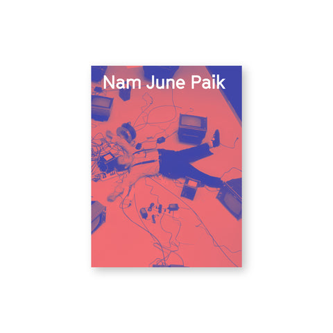 Book cover featuring an inverted color photo in pink and blue of a person lying on the ground surrounded by television sets and electronics and wires. Overlaid text at the top of the page reads: Nam June Paik.