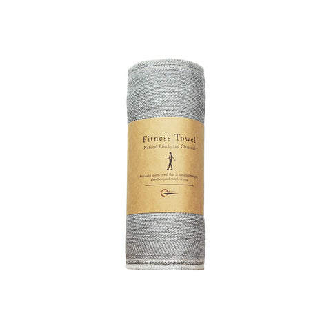 Gray fitness towel rolled with natural paper belly band packaging.