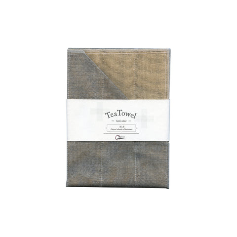 Persimmon and gray tea towel folded with white belly band packaging.