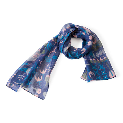Dark blue scarf with an all-over pattern of different pink, gray and blue flowers in a youthful illustration style. The scarf is looped with the ends splayed.
