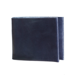 Side view of a folded Navy Flap Wallet standing on end in a white background, showing a slice of light blue leather interior.