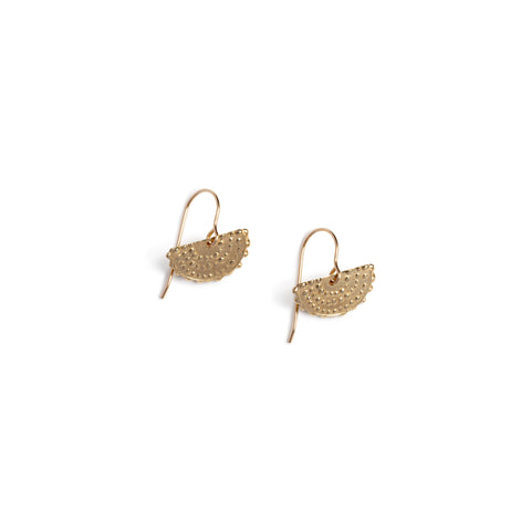 A pair of gold earrings on french wires with semi circles dangling off. The surfaces are decorated with repeating rows  of textured dots.