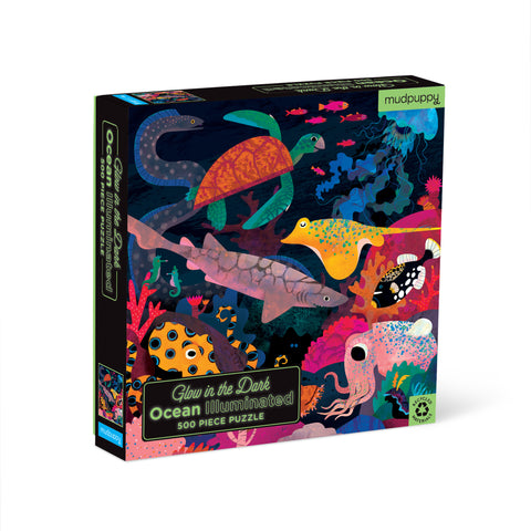 "Black, square puzzle box, standing upright, featuring a colorful illustration full of sea creatures. Puzzle title text at bottom left is green with a ""glow"" effect."