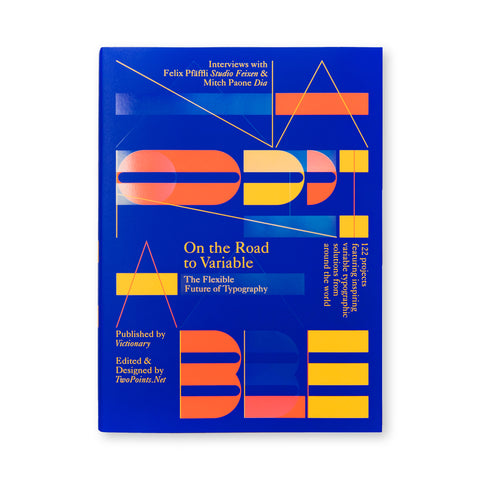 Book cover in deep blue with the title, author, publisher and  descriptions of content printed in blocks of beige type at various angles, and the word Variable spelled out over four lines of orange, yellow and blue solid and faded type.