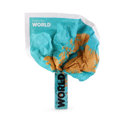 A teal crumpled piece of fabric squeezing into a small clear package labeled World. The crumpled fabric appears to orange continents on it.