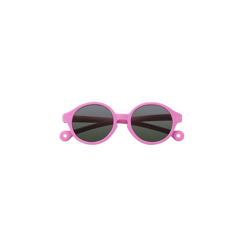 A pair of children's round framed sunglasses in a bright pink color.