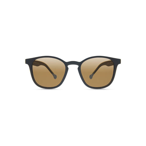 Side angle view of the Ruta Sunglasses Black/Caramel, which have black, rounded square-rectangular frames, and caramel lenses.