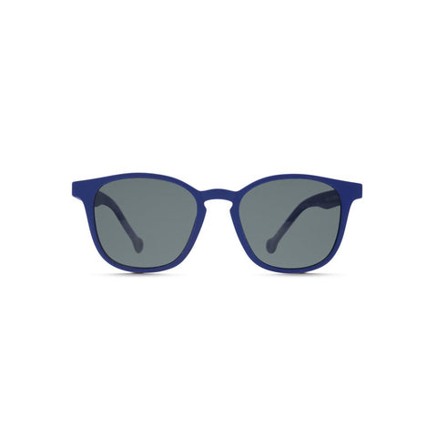 Side angle view of the Ruta Sunglasses Blue/Gray, which have blue, rounded square-rectangular frames, and gray lenses.