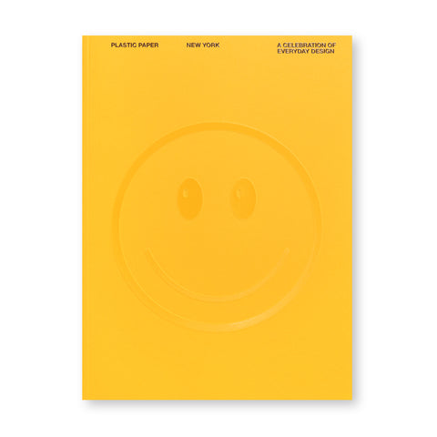 Yellow book cover with debossed smiley face at center, with debossed, small, black, sans serif title text at top in all caps.