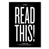 "The front of a notebook has the text ""READ THIS!"" printed in white extra large font on a solid black background."