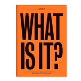 "The front of a notebook has the text ""WHAT IS IT?"" printed in an extra large bold black font. The background is a orange."