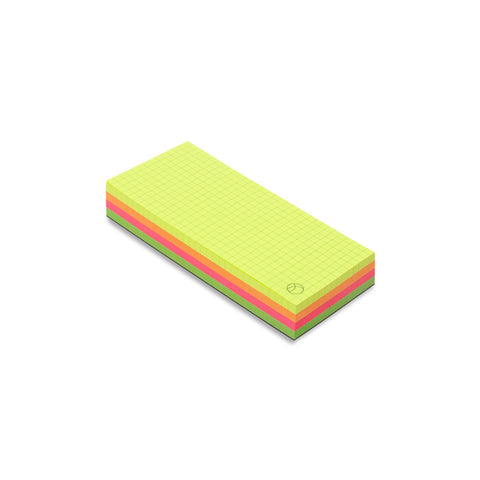 Angle view of the rectangular Multicolor Memo Pad in Neons, made up of four stacked blocks of color: neon yellow, neon orange, neon pink, neon green. The top page shows a gray grid pattern and the brand logo in the bottom right corner.