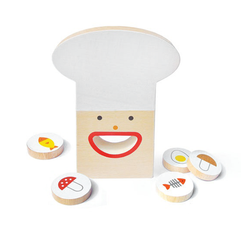 Wooden flat head with a cheer white hat, two small rounded eyes, and a big smiling mouth. Five wooden disks featuring food items such as mushroom, egg, and fish,